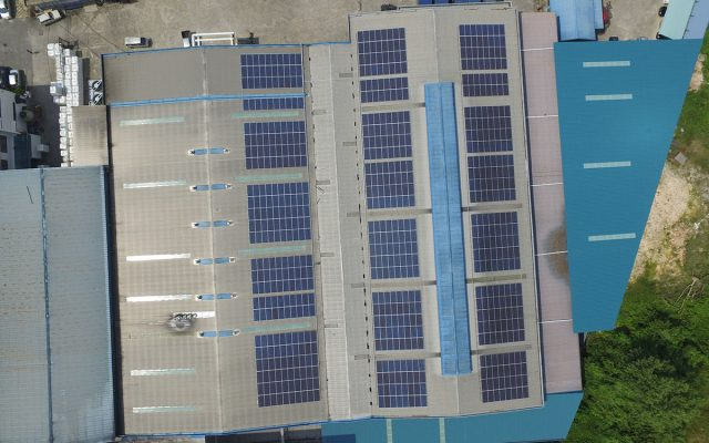 rooftop solar panels above factory