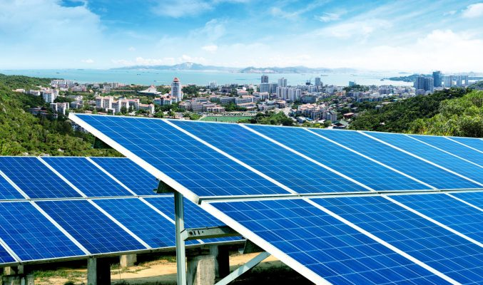 Solar panels in front of the city skyline, Xiamen, China